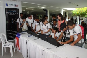 "Maria Snarski, Regional Language Officer for Brazil, with students trying, for the first time - the free English Language learning video game ""Trace Effects"" sponsored by the US State Department."